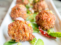 Thai spicy meat ball on white dish Royalty Free Stock Images
