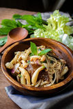 Thai spicy mushroom salad in wooden bowl Royalty Free Stock Photography