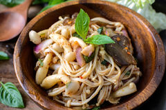 Thai spicy mushroom salad in wooden bowl Stock Image
