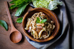 Thai spicy mushroom salad in wooden bowl Stock Photography