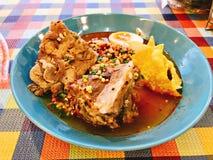 Thai spicy noodle soup with pork bone. Thai spicy noodle soup with pork bone served with crispy wonton skin royalty free stock photos