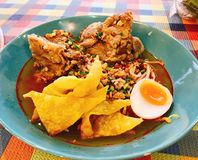 Thai spicy noodle soup with pork bone. Thai spicy noodle soup with pork bone served with crispy wonton skin Stock Image