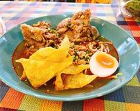 Thai spicy noodle soup with pork bone. Thai spicy noodle soup with pork bone served with crispy wonton skin stock photos