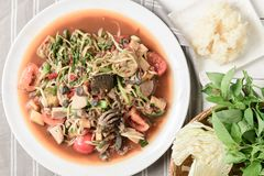 Thai Spicy papaya salad with pork sausage, Salted crab. Scald snail and Sticky rice on top view: Popular Thai Cuisine food royalty free stock photography