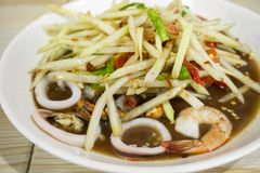 Thai Spicy papaya salad with seafood, Famous Thai food,. `Somtum Stock Photography