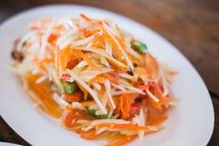 Thai spicy Papaya Salad. In white plate Stock Image