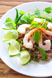 Thai spicy pork and shtimp salad. Served with fresh lime and cilantro royalty free stock photos