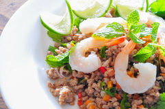 Thai spicy pork and shtimp salad. Served with fresh lime and cilantro royalty free stock images