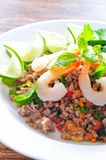 Thai spicy pork and shtimp salad. Served with fresh lime and cilantro stock photos
