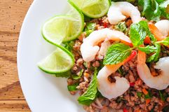 Thai spicy pork and shtimp salad. Served with fresh lime and cilantro stock image