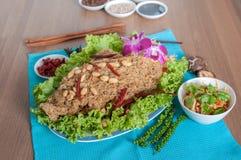 Thai spicy salad with catfish menu Stock Images