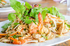 Thai Spicy salad with chicken, shrimp, fish and vegetables. On white dish Royalty Free Stock Photo