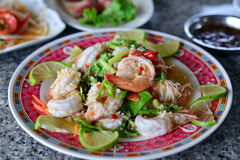 Thai Spicy salad with chicken, shrimp, fish and vegetables. On white dish Royalty Free Stock Images
