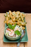 Thai spicy salad. Thai spicy seafood salad with deep-fried morning glory royalty free stock photos