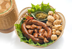 Thai spicy sausage or Sai Aua is name in northern Thailand.Kantoke, traditionally meal set. Was popular in North of Thailand Royalty Free Stock Image