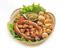Thai spicy sausage or Sai Aua is name in northern Thailand.Kantoke, traditionally meal set. Was popular in North of Thailand Stock Photography