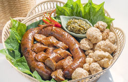 Thai spicy sausage or Sai Aua is name in northern Thailand.Kantoke, traditionally meal set. Was popular in North of Thailand Royalty Free Stock Photos