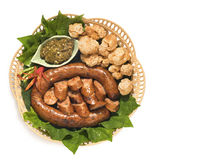 Thai spicy sausage or Sai Aua is name in northern Thailand.Kantoke, traditionally meal set. Was popular in North of Thailand Royalty Free Stock Photography