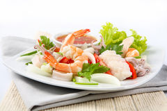 Thai spicy  with seafood on the plate Stock Photo