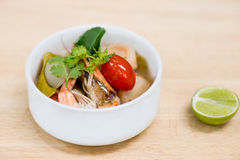 Thai spicy soup ready to serve for one person. Tom yum goong ,thai famous food royalty free stock photos