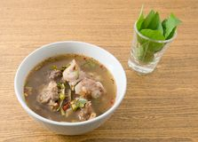 Thai Spicy and Sour Beef Entrails Soup with Basil Royalty Free Stock Photos
