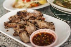 Thai spicy tasty food. Thai spicy food, griil pork and papaya salad Stock Photo