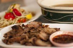 Thai spicy tasty food. Thai spicy food, griil pork and papaya salad Stock Images