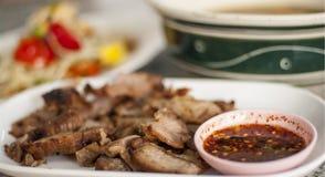 Thai spicy tasty food. Thai spicy food, griil pork and papaya salad Stock Photos