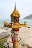 Thai spirit house in front of sea landscape Stock Photography