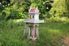 Thai Spirit House. A Thai spirit house on the side of the road Stock Photo