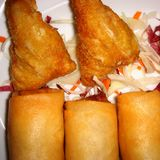 Thai spring rolls and fried shrimps. Served in a restaurant royalty free stock photo
