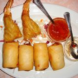Thai spring rolls and fried shrimps. Served in a restaurant royalty free stock photography