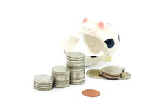 Thai stack coins with broken piggy bank on white background Stock Image