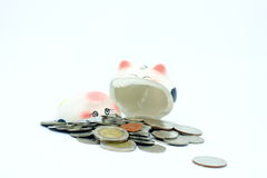 Thai stack coins with broken piggy bank on white background Stock Images