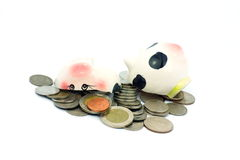 Thai stack coins with broken piggy bank on white background Royalty Free Stock Photos