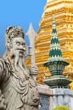 Thai Statue. And architectural detail at the Temple of the Emerald Buddha, Bangkok, Thailand Royalty Free Stock Photo
