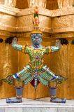 Thai Statue. And architectural detail at the Temple of the Emerald Buddha, Bangkok, Thailand Stock Image