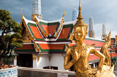 Thai Statue. Golden Thai Statue at the Temple of the Emerald Buddha, Bangkok, Thailand Stock Photo