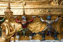 Thai Statue. And architectural detail at the Temple of the Emerald Buddha, Bangkok, Thailand Royalty Free Stock Photos