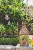 Thai statue in a garden. Royalty Free Stock Photo