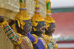 Thai statues. Thai Buddhist statues in the Grand Palace, Bangkok royalty free stock photography