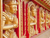 Thai statues on the temple wall. Stock Image