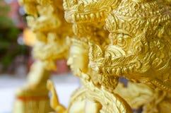 Golden sculptures. Thai statues under Big Buddah Stock Photography