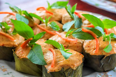 Thai steamed curry fish in banana leaf cups decorated with basil leaf, (Hor Mok Pla) Stock Photography