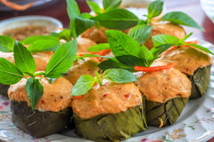 Thai steamed curry fish in banana leaf cups decorated with basil leaf, (Hor Mok Pla) Royalty Free Stock Photography