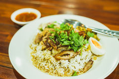 Thai Stewed pork leg. On rice with garlic and kale on wooden table Stock Photography