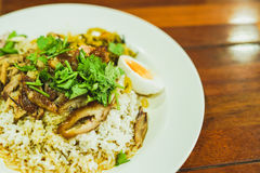 Thai Stewed pork leg. On rice with garlic and kale on wooden table Stock Photos