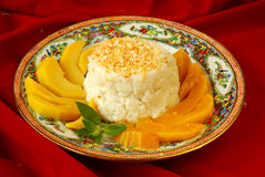 Thai sticky rice. With grilled coconut and mango Stock Image