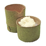 Thai sticky rice in a bamboo wooden box on white background Stock Photo