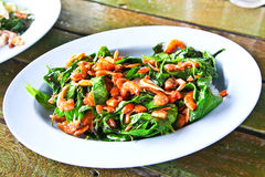 Thai stir fried green vegetables with dried shrimps Stock Image